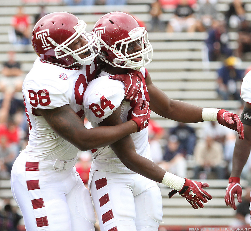September 24, 2011; College Park, MD, USA; Temple Owls defensive lineman Levi Brown (99) and wide receiver Malcolm Eugene (84) celebrate a blocked punt against the Maryland Terrapins during first half at Byrd Stadium in College Park, Maryland. Brian Schneider-www.ebrianschneider.com