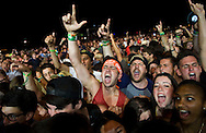 Fans rock out during the Descendents' set on the second day of the 2013 Coachella Valley Music and Arts Festival in Indio, Calif. Saturday....///ADDITIONAL INFO:   ..coachella2.0414.kjs  ---  Photo by KEVIN SULLIVAN / Orange County Register  --  4/13/13..Day 2 of the 2013 Coachella Valley Music and Arts Festival in Indio, Calif. ..4/13/13..