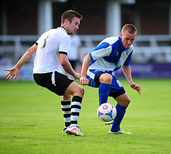 Bristol Rovers' Eliot Richards  holds the ball up well from Hereford United's Chris Bush - Photo mandatory by-line: Dougie Allward/JMP - Tel: Mobile: 07966 386802 16/07/2013 - SPORT - FOOTBALL - Bristol -  Hereford United V Bristol Rovers - Pre Season Friendly