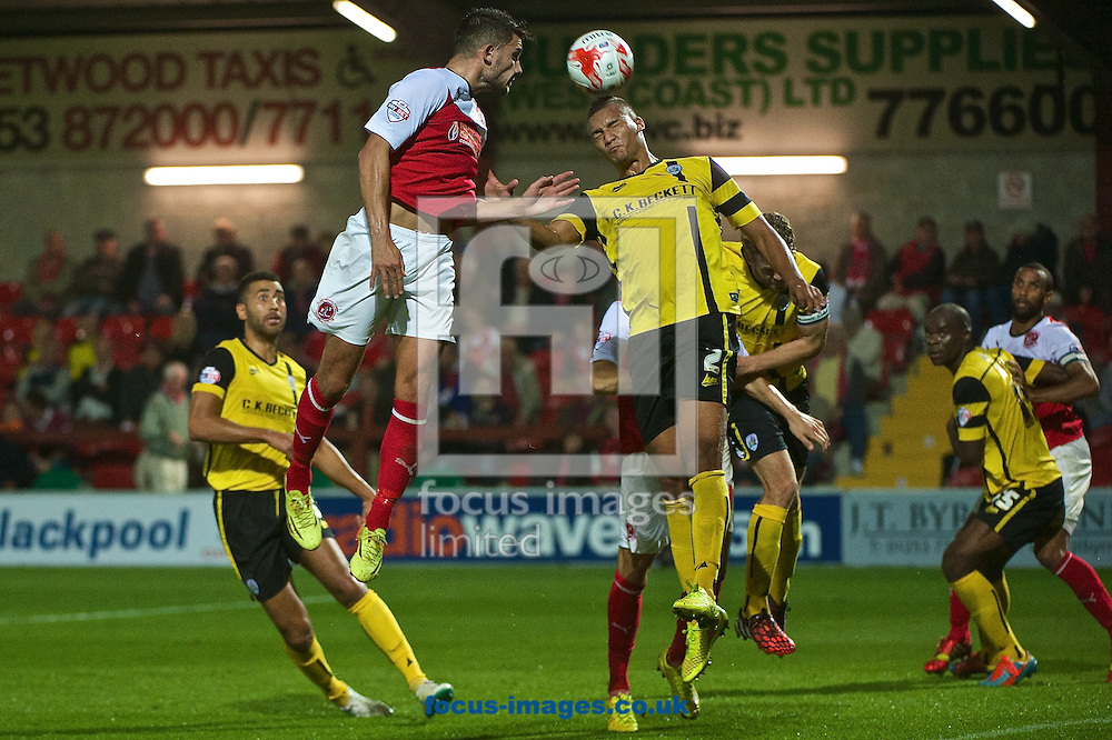 Gareth Evans of Fleetwood Town heads at goal during the Sky Bet League 1 match at the Highbury Stadium, Fleetwood<br /> Picture by Ian Wadkins/Focus Images Ltd +44 7877 568959<br /> 17/09/2014