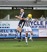 Dundee's Paul McGinn out jumps Dunfermline's  Jason Talbot - Dunfermline Athletic v Dundee - Scottish League Cup at East End Park<br /> <br />  - &copy; David Young - www.davidyoungphoto.co.uk - email: davidyoungphoto@gmail.com