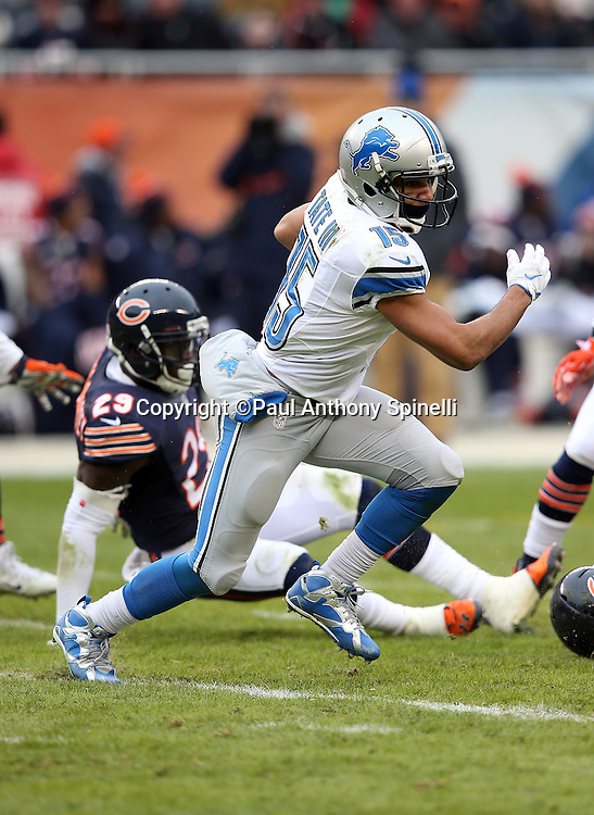 Detroit Lions wide receiver Golden Tate (15) catches a pass and runs for a second quarter gain of 11 yards during the NFL week 17 regular season football game against the Chicago Bears on Sunday, Jan. 3, 2016 in Chicago. The Lions won the game 24-20. (©Paul Anthony Spinelli)