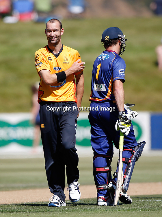 Firebirds Andy McKay has words with Aaron Redmond during the Twenty20 Cricket - HRV Cup, Otago Volts v Wellington Firebirds, Saturday 31 December 2011, Queenstown Events Centre, Queenstown, New Zealand. Photo: Michael Thomas/photosport.co.nz