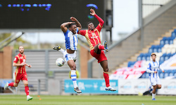 Ryan Jackson of Colchester United and Kieran Agard of Milton Keynes Dons challenge for the ball - Mandatory by-line: Arron Gent/JMP - 27/04/2019 - FOOTBALL - JobServe Community Stadium - Colchester, England - Colchester United v Milton Keynes Dons - Sky Bet League Two