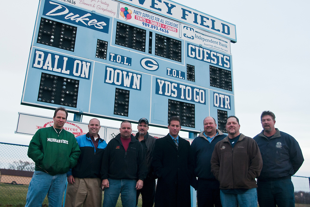 Lathan Goumas | The Bay City Times..Members of the 1984 Garber High School Football team  at the schools field in Essexville, MI. on Friday November 18, 2011. Despite being undefeated the team was left out of the playoffs. (From left to right) Linebacker Brad Williams, kicker Mike Meehleder, guard Paul Sansburn, center Matt Verhaeghe, quarterback Kevin Spencer, fullback Chris Foret, linebacker Dean Verhaeghe and linebacker Steve Savage.