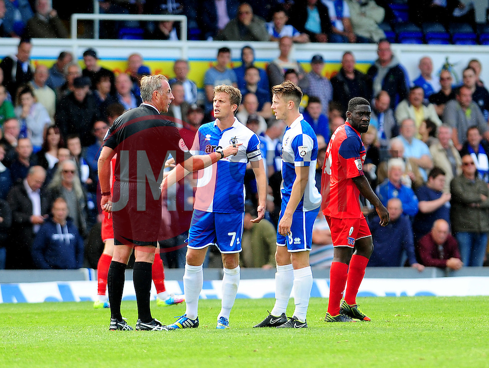 Bristol Rovers' Lee Mansell and Ollie Clarke have a chat with the referee - Photo mandatory by-line: Neil Brookman - Mobile: 07966 386802 23/08/2014 - SPORT - FOOTBALL - Bristol - Memorial Stadium - Bristol Rovers v AFC Telford - Vanarama Football Conference