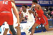 SMU Mustangs guard Emmanuel Bandoumel (5) penetrates the defense against Hartford Hawks guard Malik Ellison (1) and Miroslav Stafl (12) during an NCAA college basketball game, Wednesday, Nov. 27, 2019, in Dallas.SMU defeated Hartford 90-58. (Wayne Gooden/Image of Sport)