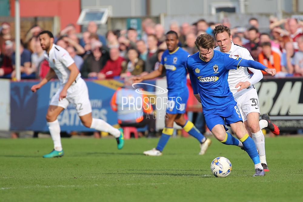 AFC Wimbledon midfielder Jake Reeves (8) passing the ball during the EFL Sky Bet League 1 match between AFC Wimbledon and Northampton Town at the Cherry Red Records Stadium, Kingston, England on 11 March 2017. Photo by Matthew Redman.