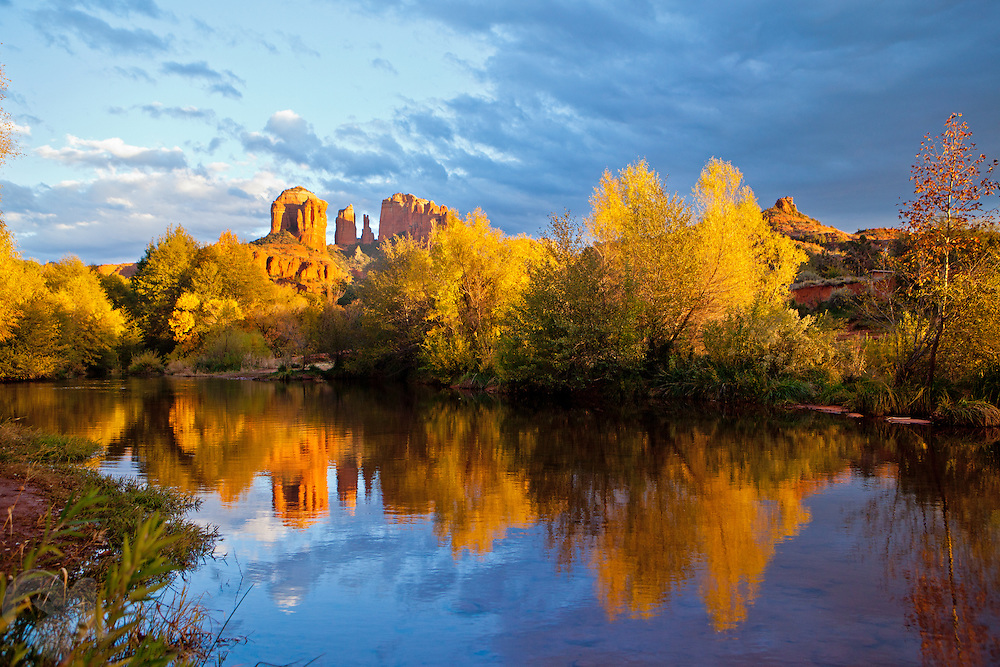 Cathedral Rock and fall color reflects in Oak Creek, near Sedona, Arizona. The area is famous for it's red rock forrmations and is a popular tourist destination.
