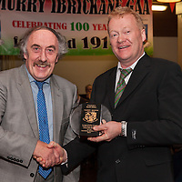 The Chairman of Kilmurry Ibrickane GAA Club Martin Lynch presents an award to the author of the history of the club David Dillon at the launch night of his book