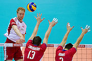 (L) Jakub Jarosz from Poland in action during the 2013 CEV VELUX Volleyball European Championship match between Poland v Slovakia at Ergo Arena in Gdansk on September 22, 2013.<br /> <br /> Poland, Gdansk, September 22, 2013<br /> <br /> Picture also available in RAW (NEF) or TIFF format on special request.<br /> <br /> For editorial use only. Any commercial or promotional use requires permission.<br /> <br /> Mandatory credit:<br /> Photo by &copy; Adam Nurkiewicz / Mediasport