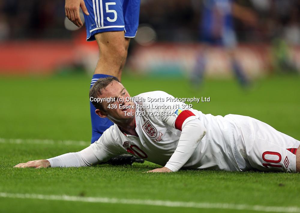 12 October 2012 Football. England v San Marino.<br /> England captain Wayne Rooney hits the floor.<br /> Photo: Mark Leech.