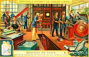 Late 19th century glass factory. In the centre a worker is making a cylinder of glass which will be flattened and formed into a sheet, mainly used for window. Liebig trade card c1900.