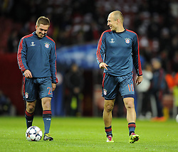 Bayern Munich's Philipp Lahm (left) and Bayern Munich's Arjen Robben (right) - Photo mandatory by-line: Joe Meredith/JMP - Tel: Mobile: 07966 386802 19/02/2014 - SPORT - FOOTBALL - London - Emirates Stadium - Arsenal v Bayern Munich - Champions League - Last 16 - First Leg