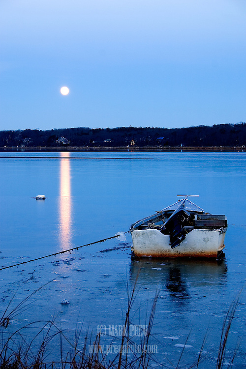 Ice enhances the moon's reflection on Town Cove.
