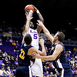December 15, 2011; Baton Rouge, LA; LSU Tigers forward Malcolm White (5) shoots over UC Irvine Anteaters guard Daman Starring (22) and forward Adam Folker (20) during the first half of a game at the Pete Maravich Assembly Center.  Mandatory Credit: Derick E. Hingle-US PRESSWIRE