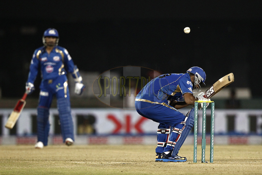 Praveen Kumar of the Mumbai Indians beat during the qualifier 2 match of the Oppo Champions League Twenty20 between the Mumbai Indians and the Lahore Lions held at the Chhattisgarh International Cricket Stadium, Raipur, India on the 13th September 2014<br /> <br /> Photo by:  Deepak Malik / Sportzpics/ CLT20<br /> <br /> <br /> Image use is subject to the terms and conditions as laid out by the BCCI/ CLT20.  The terms and conditions can be downloaded here:<br /> <br /> <br /> http://sportzpics.photoshelter.com/gallery/CLT20-Image-Terms-and-Conditions-2014/G0000IfNJn535VPU/C0000QhhKadWcjYs