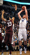 St. Louis  University basketball player Brian Conklin (14) launches a shot over Fordham University's Chris Gaston (33) during the first half of the Billikens' 66-46 Atlantic 10 win over the Rams at Chaifetz Arena on the St. Louis University campus Saturday, Feb. 18, 2012 in St. Louis. Photo © copyright 2012 Sid Hastings.