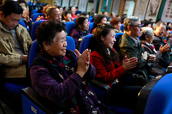 epa06264978 Chinese residents clap as they attend a forum at the Baoguosi Residential community, during a reporting trip organised by the government for journalists ahead of the 19th National Congress in Beijing, China, 14 October 2017. The Communist Party of China (CPC) is making preparations for the five-yearly 19th National Congress scheduled to begin next week on 18 October. During the Congress members will elect a new Central Committee, including a new 24-member Politburo and a new seven-member Standing Committee.  EPA-EFE/HOW HWEE YOUNG