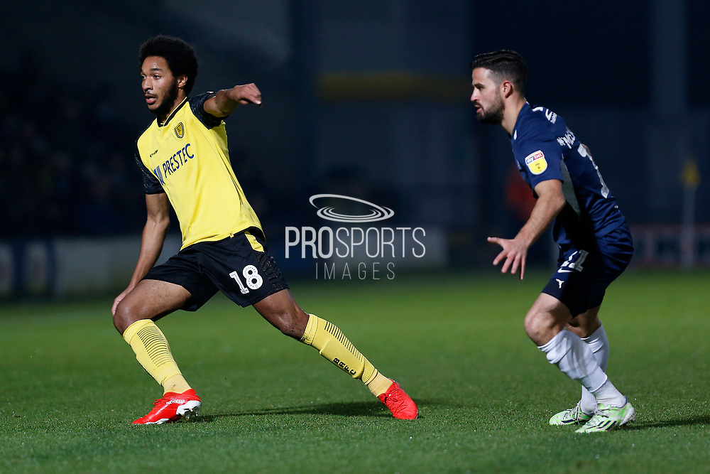 Richard Nartey and Stephen McLaughlin in action during the EFL Sky Bet League 1 match between Burton Albion and Southend United at the Pirelli Stadium, Burton upon Trent, England on 3 December 2019.