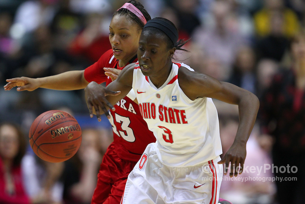 March 03, 2012; Indianapolis, IN, USA; Nebraska Cornhuskers guard Brandi Jeffery (13) and Ohio State Buckeyes guard Amber Stokes (3) battle for a loose ball during the semifinals of the 2012 Big Ten Tournament at Bankers Life Fieldhouse. Nebraska defeated Ohio State 77-62. Mandatory credit: Michael Hickey-US PRESSWIRE
