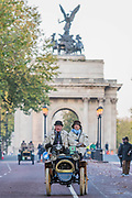 Leaving Hyde Park after the start and heading down Constitution hill to pass Buckingham Palace - The London to Brighton Veteran Car Run, which dates back to 1927, was founded to commemorate the Emancipation Run of 1896, which celebrated the new-found freedom of motorists granted by the 'repeal of the Red Flag Act.' The Act raised the speed limit to 14mph and abolished the need for a man carrying a red flag to walk ahead of the cars whenever they were being driven. It is the longest running motoring event in the world, this year has a French theme in honour of the country's contribution to motoring's early days. It is is organised by the Royal Automobile Club.