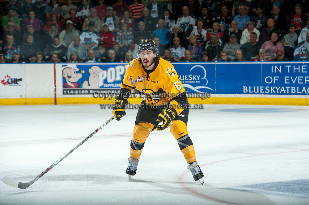 KELOWNA, CANADA - MAY 13: Ryan Pilon #6 of Brandon Wheat Kings skates with the puck against the Kelowna Rockets on May 13, 2015 during game 4 of the WHL final series at Prospera Place in Kelowna, British Columbia, Canada.  (Photo by Marissa Baecker/Shoot the Breeze)  *** Local Caption *** Ryan Pilon;