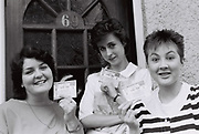 Three women holding their tickets to Live Aid, Southall, UK, 1985