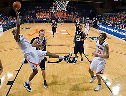 Virginia guard Sylven Landesberg (15) shoots a one handed fade away. The Virginia Cavaliers defeated the Shepherd Rams 87-52 in an NCAA basketball exhibition game at the University of Virginia's John Paul Jones Arena in Charlottesville, VA on November 9, 2008.
