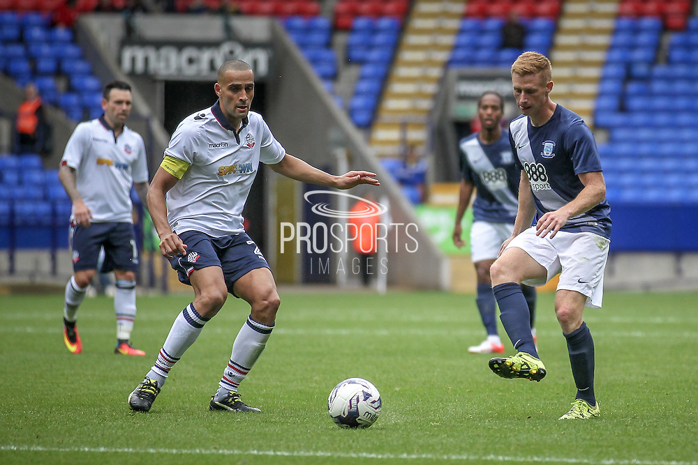 Eoin Doyle (Preston North End) passes the ball across Darren Pratley (Bolton Wanderers) during the Pre-Season Friendly match between Bolton Wanderers and Preston North End at the Macron Stadium, Bolton, England on 30 July 2016. Photo by Mark P Doherty.