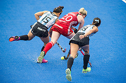 Great Britain's Hollie Webb battles with Maria Jose Granatto and xxx of Argentina. Great Britain v Argentina  - Hockey Champions Trophy, Lee Valley Hockey & Tennis Centre, London, UK on 18 June 2016. Photo: Simon Parker
