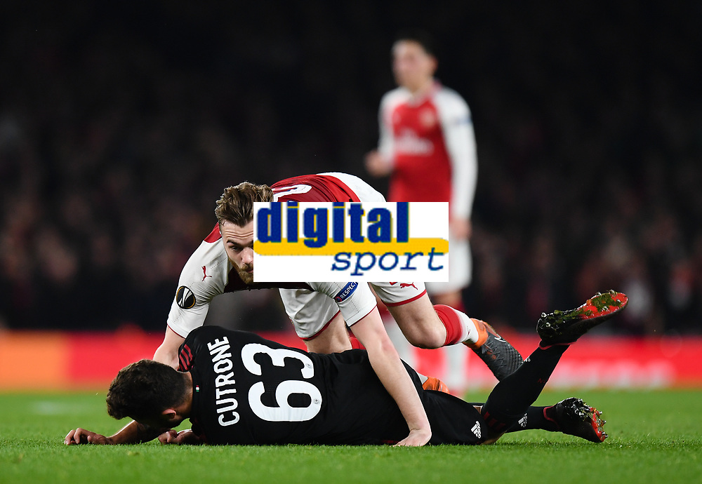 Football - 2017 / 2018 UEFA Europa League - Round of Sixteen, Second Leg: Arsenal (2) vs. AC Milan (0)<br /> <br /> Arsenal's Calum Chambers battles with AC Milan's Patrick Cutrone<br /> <br /> COLORSPORT/ASHLEY WESTERN