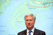 © Licensed to London News Pictures. 29/09/2014. Birmingham, UK. The Defence Secretary Michael Fallon stands in front of a map of the Falkland Island. The Conservative Party Conference in Birmingham 29th September 2014. Photo credit : Stephen Simpson/LNP