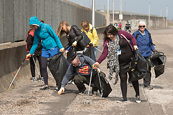 The Big Walk, organised by the Eden Project, came to Portobello this morning. Four people set off from Morecambe to walk home to each of the nations of the UK. Scotland's representative is Angis McLeod from Dundee and this morning he met with representatives from local groups in Portobello, as well as taking part in a small litter clean-up and leading some community singing at the end of the Prom.  Pictured:<br /> <br /> <br /> © Jon Davey/ EEm