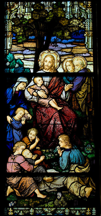 """Stained glass image inside Sacred Heart Church, Sherwood, Wis., depicting Jesus with children -- as described in Matthew's Gospel: """"Let the little children come to me, and do not hinder them, for the kingdom of heaven belongs to such as these."""" (Sam Lucero photo)"""