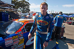 ROSEVILLE, CA - OCTOBER 13: Derek Thorn, driver of the #6 Sunrise Ford/Lucas Oil/Eibach Ford steps out of his car during practice for the NASCAR K&N Pro Series West Toyota/NAPA 150 at the All American Speedway on October 13, 2012 in Roseville, California. (Photo by Jason O. Watson/Getty Images for NASCAR) *** Local Caption *** Derek Thorn