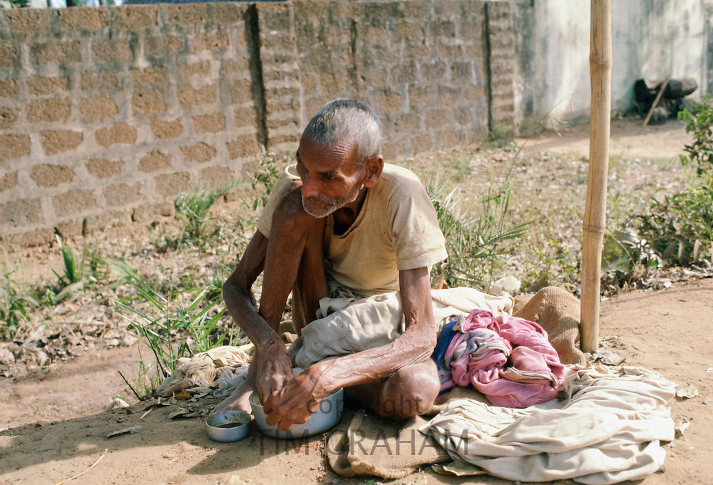Life on the streets for Indian man living by the roadside in India