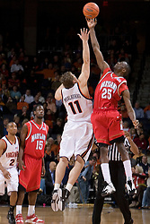 Maryland's Ekene Ibekwe (25) wins the opening tip over Virginia's Laurynas Mikalauskas (11).  The Cavaliers defeated the #22 ranked Terrapins 103-91 at the John Paul Jones Arena in Charlottesville, VA on January 16, 2007.