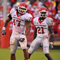 Sep 26, 2009; College Park, MD, USA; Rutgers linebacker Damaso Munoz (17) and cornerback Devin Mccourty (21) celebrate a turnover on downs during Rutgers' 34-13 victory over Maryland in NCAA college football at Byrd Stadium.