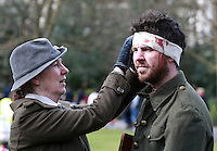 &quot;Rebel &quot; Oisin Mc Kiernan pictured with his Mum Eibhlin, both from Clondalkin, as she tends to his wounds during an enactment of the rising in Dublin's St Stephens Green. Picture Credit:Frank Mc Grath<br /> 28/3/16