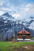 A house with Alps as backdrop
