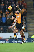 Hull City striker Abel Hernandez and Burnley midfielder Joey Barton go for the ball in the air  during the Sky Bet Championship match between Hull City and Burnley at the KC Stadium, Kingston upon Hull, England on 26 December 2015. Photo by Ian Lyall.