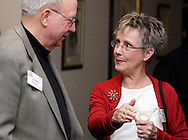 John Spain (left) and Elaine Middlestetter of Concept Company during the holiday meeting of the American Advertising Federation at the NCR Country Club in Kettering, Thursday, December 15, 2011.