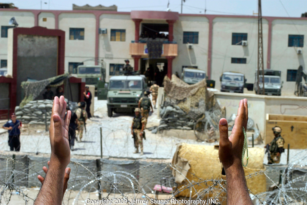 Carabinieri and Italian army guard the City Council Building in Nasiriyah, Iraq, Monday, August 11, 2003. Approximately 3000 protestors marched on the building, where Coalition Provencial Authority instilled city council members where holed up, demanding they resign and the citizens have the right to elect their own leaders. Heavily armed Italian troops guarded the buiding as Italian helicopters flew overhead. After several hours of negotiations, the protestors said they would not leave until the resignations were complete. Apparently by the end of the day, the resignations finally came.