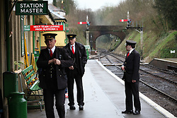 © Licensed to London News Pictures. 07/03/2014. Hampshire, UK. Station staff at Alresford Station today, 7th March 2014, which is the first day of the 'spring steam gala' on the Watercress Line. The railway line, operated by Mid Hants Railway Ltd, passes between Alresford and Alton in Hampshire. The line is named after its use in the past for transporting freshly cut watercress from the beds surrounding Alresford to London. Photo credit : Rob Arnold/LNP