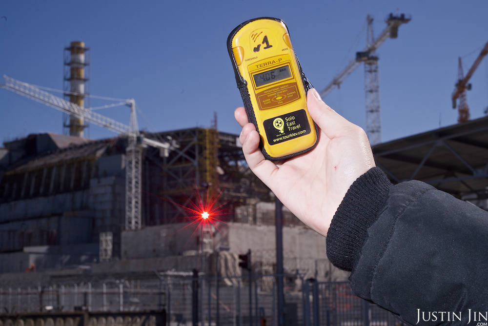 A geiger counter showing high radioactivity outside the decommissioned Chernobyl power station reactor number 4. <br /> <br /> 30 years on, the plant is still heavily contaminated, unfit for human life. <br /> <br /> The Chernobyl nuclear disaster happened on 26 April 1986. The ferris wheel was scheduled to be unveiled a few days after the disaster, but was never used.