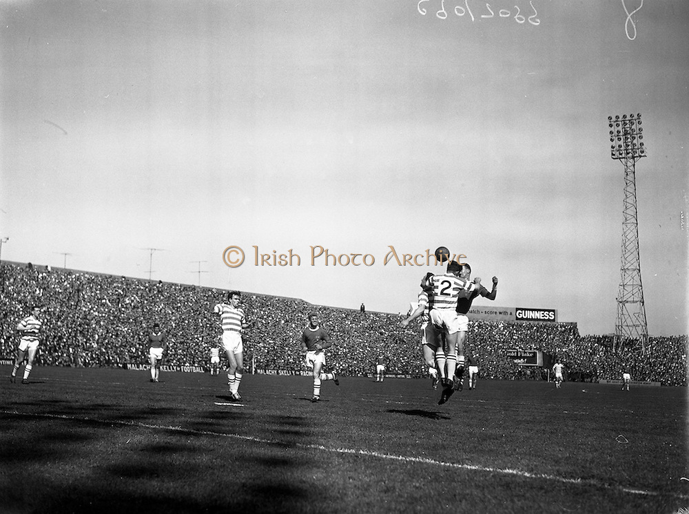 29/04/1962<br /> 04/29/1962<br /> 29 April 1962<br /> Shamrock Rovers v Shelbourne in the F.A.I. Cup Final at Dalymount Park, Dublin. Shamrock Rovers defenders Keogh (no.2) and Courtney, jump for the ball with a Shelbourne forward.