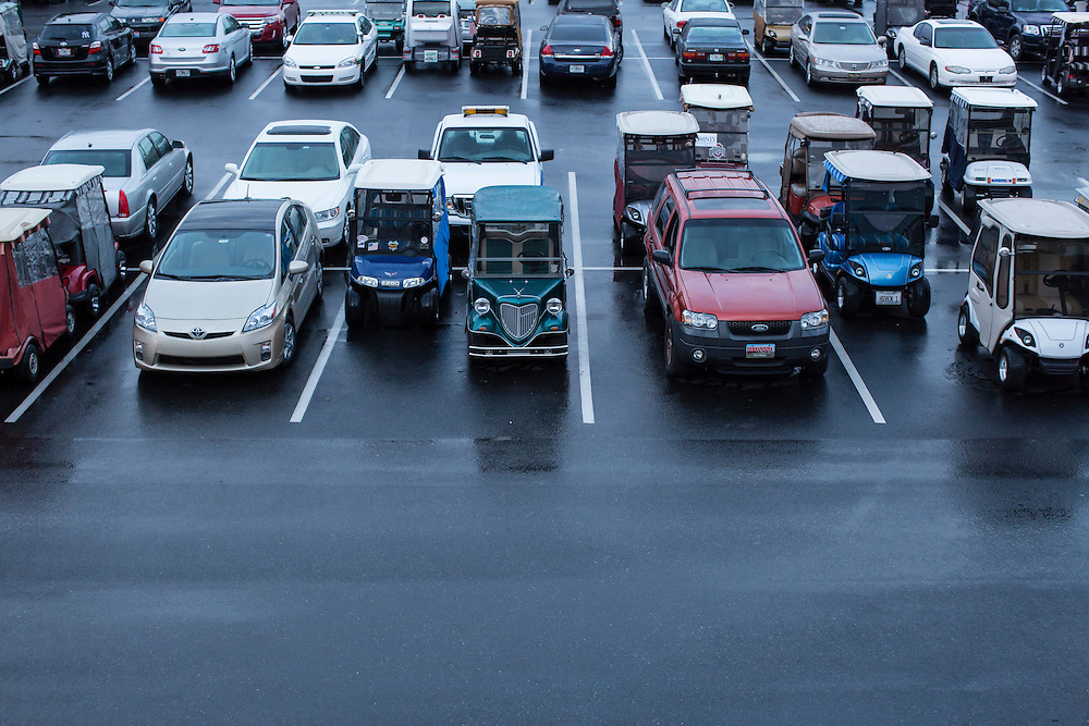 Golf carts mix with cars in the parking lot before a campaign rally with Republican Vice Presidential candidate  Rep. Paul Ryan (R-WI) on Saturday, August 18, 2012 in The Villages, FL.
