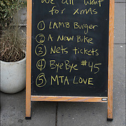 Blackboard Christmas Sign &quot;Top things we all want for Xmas<br /> (1) Lamb Burger  (2) New Bike  (3) Net tickets  (4)ByeBye # 45 (5) MTA Love&quot;