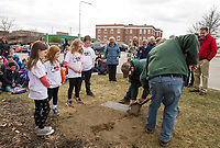 Olivia Cotnoir, Lucy Dudek, Ellen Valovanie and Riley Wilson look on as Tyler Smith and Dan Camire from Laconia Public Works begin to dig up the 1993 time capsule on the front lawn of Laconia City Hall Wednesday afternoon.   (Karen Bobotas/for the Laconia Daily Sun)